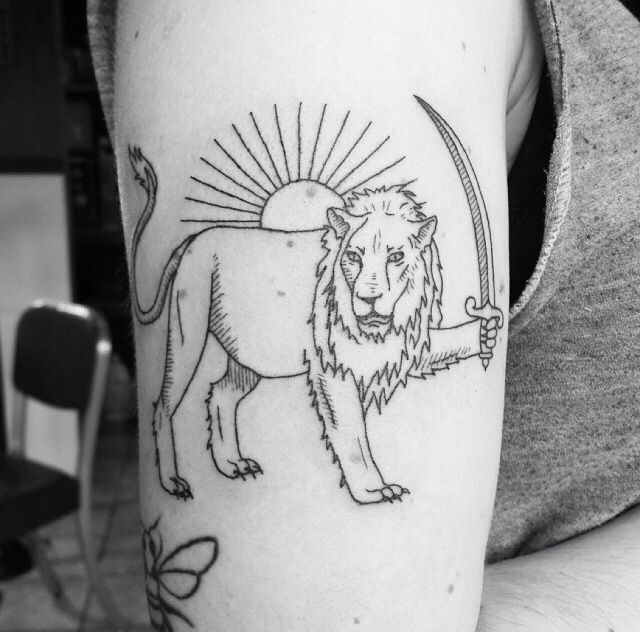 Brilliant lion with a sword tattoo
