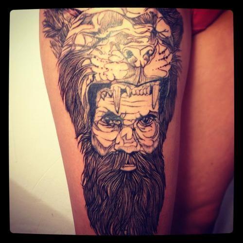 Brilliant man with tiger head tattoo