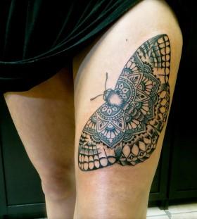 Brilliant moth leg tattoo