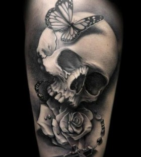 Brilliant skull and flower tattoo
