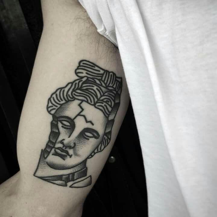 Broken sculpture tattoo by Charley Gerardin