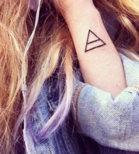 Brown hair and triangle tattoo
