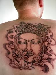 Buddha and flowers tattoo