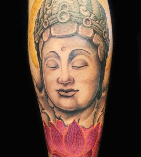 Buddha and lotus flower leg tattoo