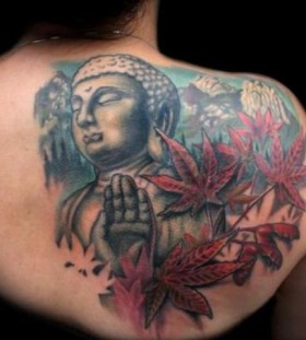 Buddha and maple leaves tattoo