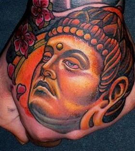 Buddha hand tattoo by Lars Uwe Jensen
