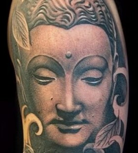 Buddha tattoo on arm
