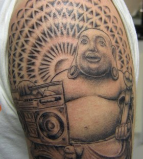 Buddha with a boombox tattoo
