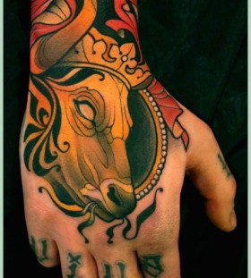 Bull with crown tattoo by Lars Uwe Jensen