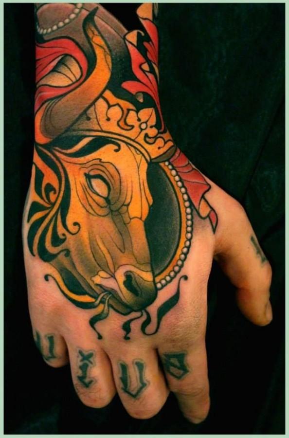 Bull with crown tattoo by Lars Uwe Jensen