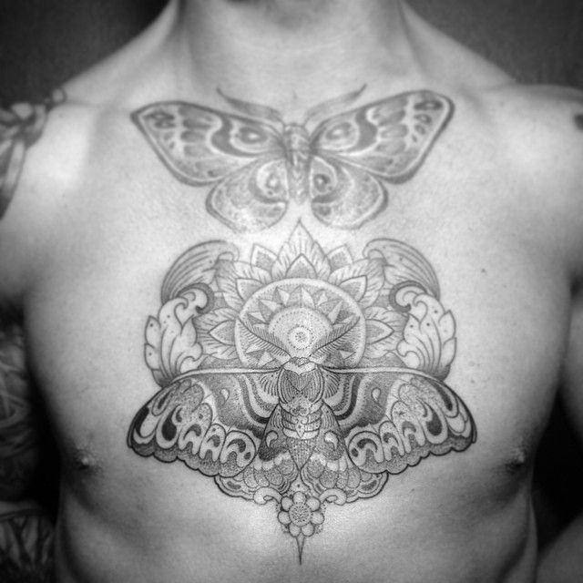 Buterflies chest tattoo by Pepe Vicio
