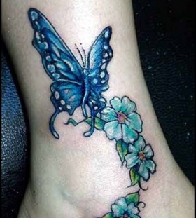Butterfly and flowers ankle tattoo