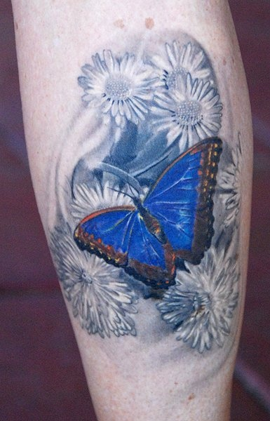 Butterfly and flowers tattoo by Phil Garcia