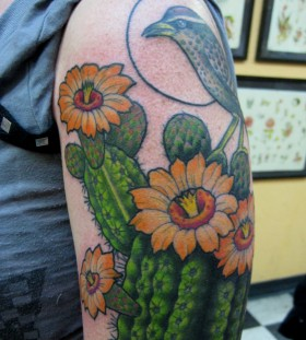 Cactus and bird tattoo