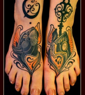 Cat and fish foot tattoos by Lars Uwe Jensen