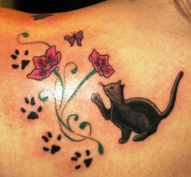 Cat paws and flowers tattoo