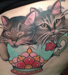 Cats in a teacup tattoo by Clare Hampshire