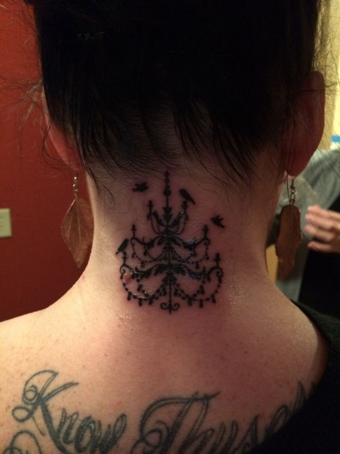 Chandelier tattoo on back of neck