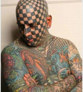 Cherckers face tattoo