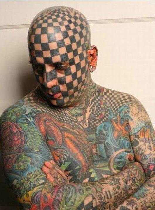 Cherckers face tattoo