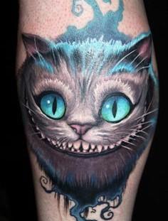 Cheshire cat tattoo by James Tattooart