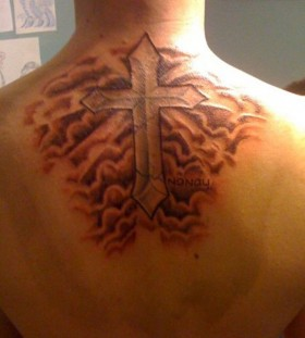 Clouds and cross tattoo