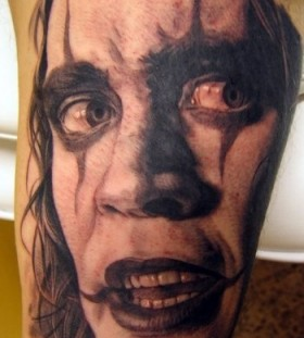 Clown portrait tattoo by Xavier Garcia Boix