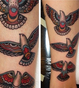 Colorful and black tribal bird tattoo