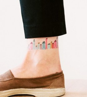 Colorful leg's town tattoo