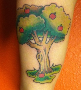 Coloured apple tree tattoo