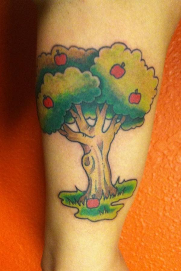 Coloured apple tree tattoo