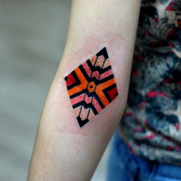 Coloured arm tattoo by Brian Gomes