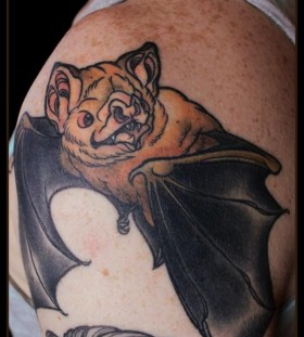 Coloured bat shoulder tattoo