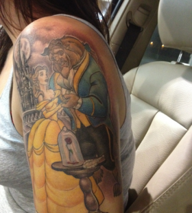 Coloured beauty and the beast tattoo
