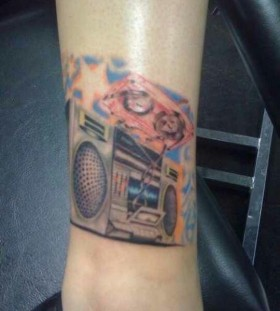 Coloured boombox leg tattoo