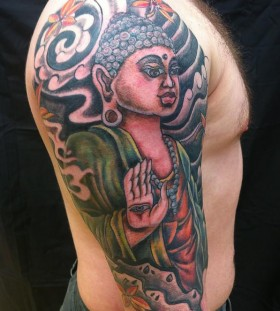 Coloured buddha arm tattoo