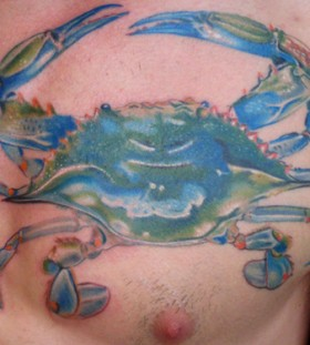 Coloured crab chest tattoo