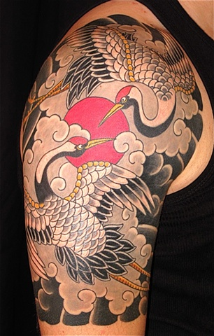 Coloured crane shoulder tattoo