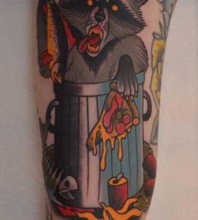 Coloured eating raccoon tattoo