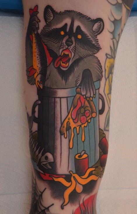 Coloured eating raccoon tattoo