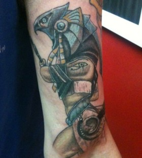 Coloured egyptian god arm tattoo