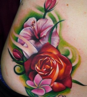 Coloured flowers tattoo by Kyle Cotterman