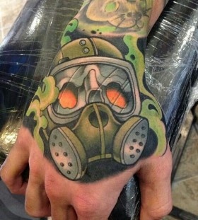 Coloured gas mask hand tattoo