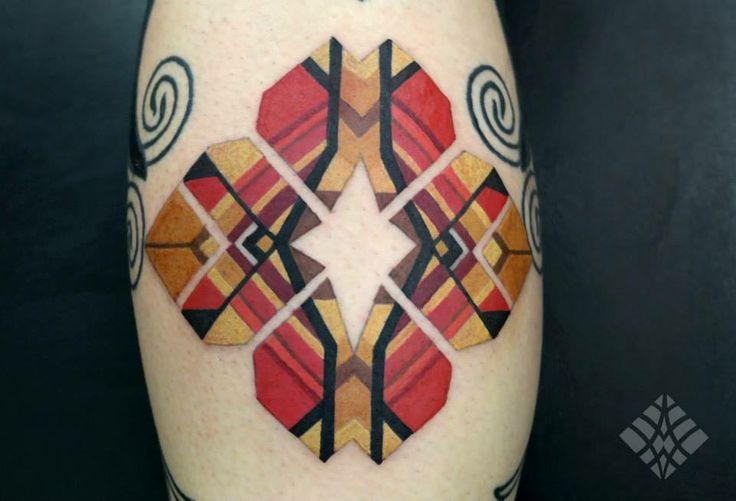 Coloured geometrical tattoo by Brian Gomes