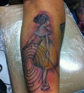 Coloured girl and maze tattoo