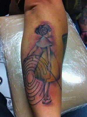Coloured girl and maze tattoo