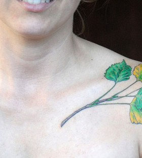 Coloured leaves collarbone tattoo