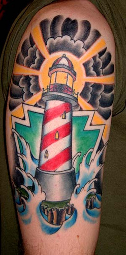 Coloured lighthouse arm tattoo