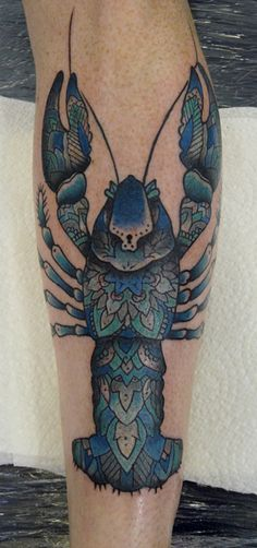 Coloured lobster leg tattoo