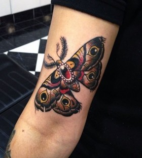 Coloured moth arm tattoo
